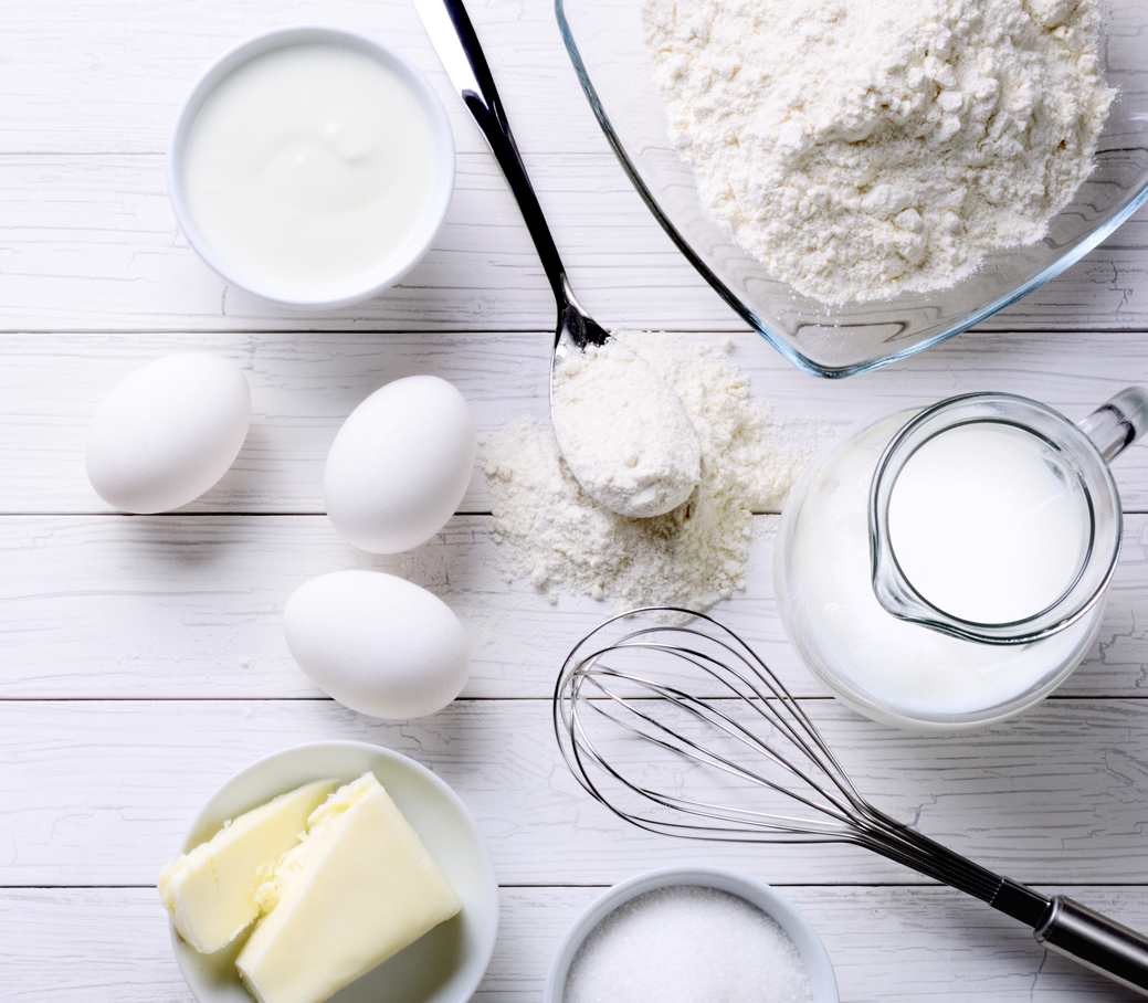 White Background With Baking Tools And Ingredients For Cakes